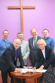 Covenant signing, back, from left: Rev John Alderdice, Methodist Chaplain at Queen's; Prof Alan Hibbert, Chair, Church of Ireland Executive Committee; Rev Donald Ker, Methodist chair of the Chaplaincy Committee; Rev Barry Forde, Church of Ireland Chaplain at Queen's. Front, L-R The Rt Rev Alan Abernethy, Bishop of Connor and Rev Heather Morris, Methodist District Superintendent.