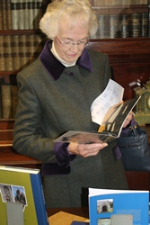 Heather Kingan, whose father Cuthbert Peacocke was Dean of Belfast in the 1960s, peruses the displays at the new Cathedral library.