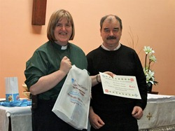 The Rev Arlene Moore, Priest in Charge of the Church of the Good Shepherd, with her certificate presented by tutor Niall Maclochlainn.