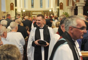 The Rev Jason Kernohan meets some members of the congregation during the recessional hymn.