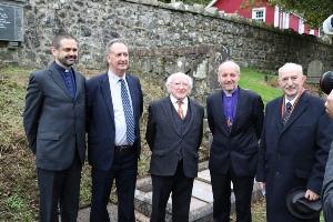 The Rev Andrew Kerr, Mr Robert Williamson, President Michael D Higgins, Bishop Alan Abernethy and Dr Ian Adamson OBE at the grave of Sir Samuel Ferguson.