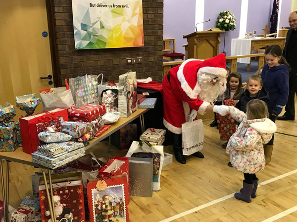Santa collects gifts from Holy Trinity Woodburn!
