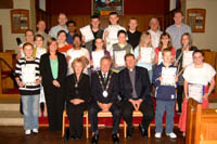 The Mayor of Lisburn, Councillor Trevor Lunn and Mayoress Mrs Laureen Lunn pictured with young people who received Certificates of Achievement at a Family Service in St Paul's Parish Church, Lisburn.
