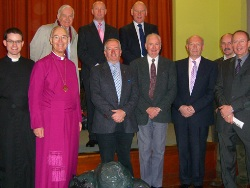 The Bishop of Connor, the Rt Rev Alan Harper, Curate Assistant at Agherton, the Rev Niall Sloane, and members of Agherton Men's Society with some of the bags they collected for the Minsk orphanage.