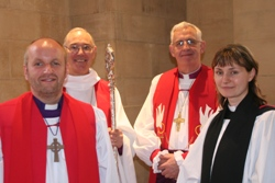 The new Bishop of Connor, the Rt Rev Alan Abernethy, left, pictured at his consecration in St Anne's Cathedral on June 29 with Archbishop Alan Harper and Archbishop John Neil, and the Rev Helen Houston who preached at the service.