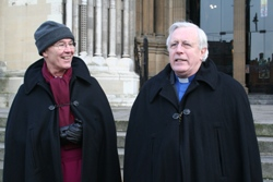 The Bishop of Connor and the Dean of Belfast share a joke during the Black Santa sit out.
