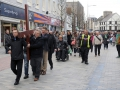 Lisburn city centre ministers pictured leading the 'Good Friday carrying of the cross walk of witness' as the procession makes its way along Bow Street to the front of Lisburn Cathedral for a short act of worship.