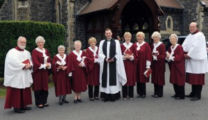 The Rev Jason Kernohan pictured with the parish choir prior to the service of institution.