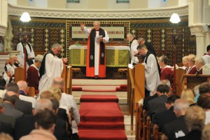 The Rt Rev RHA Eames gives the blessing at the service of Instution of the Rev Jason Kernohan in Eglantine Parish Church.