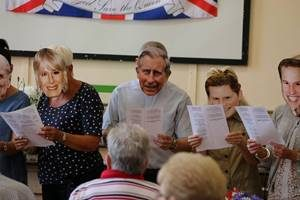 The (not real!) Royal family lead the birthday sing-a-long!