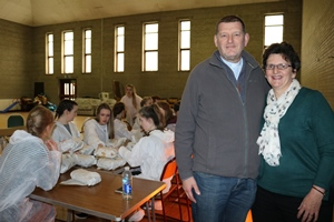 The Rev Canon Jim Carson and Mrs Heather Carson. The young painters tuck into lunch behind them.