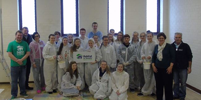 Students from Carrick Grammar School and St Dominic's who are taking part in the Habitat for Humanity project at St Michael's, Belfast.