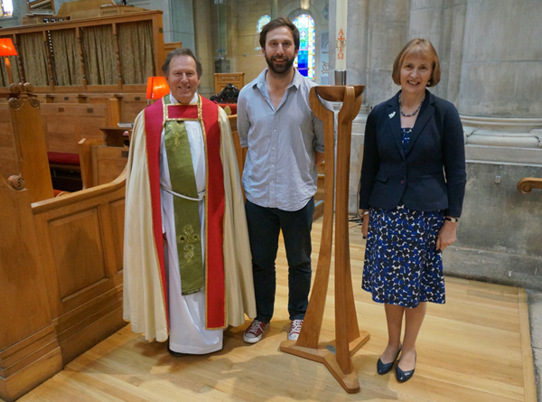 Dean and Mrs Mann present candle stand to St Anne's