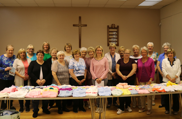 Knit and Natter group makes donation to Baby Basics