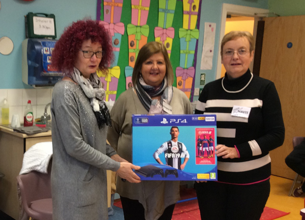 East Connor MU presents PS4 to Child Contact Centre
