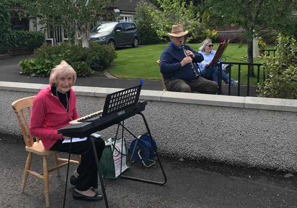 Alicia leads her neighbours in Sunday sing-a-long