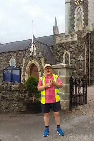 The Rev Canon Derek Kerr broadcasting online at the end of his 15 mile walk celebrating his 30 years in ministry.