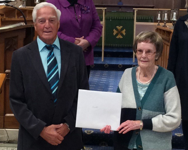 Choir member retires after 59 years' service