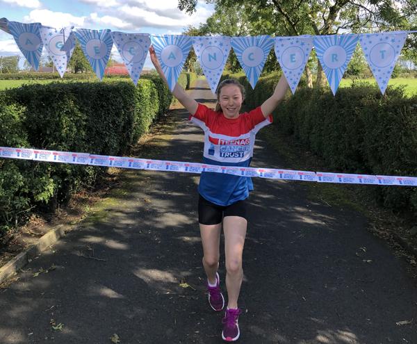 Lauren (13) finishes her 100 mile fundraising run