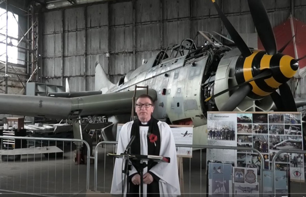 The Rev Arthur Young leading St Paul's online Remembrance Sunday Service in a hangar at the Ulster Aviation Society