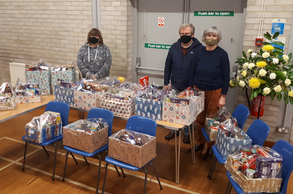 Rector of Magheragall, the Re Nicholas Dark, with Susan and Browen and hampers put together in the church hall.