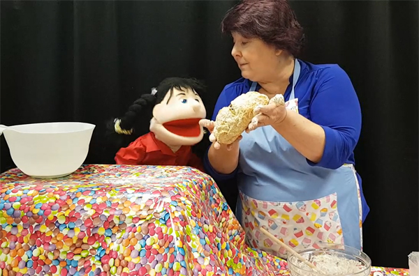 Rosie the puppet advises chef Karen Webb on the consistency of her dough!