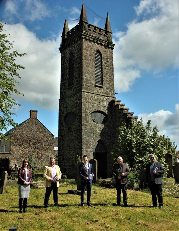 Pictured in front of Old Tower, site of the original church, are Roy Smith, a direct descendant of the Adair family; Cllr Peter Johnston, Mayor of Mid and East Antrim Borough Council; James Perry MBE; Deputy Lieutenant for County Antrim; and the Rev Canon Mark McConnell. Photo: Loraine Watt.
