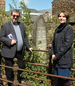 Pictured beside the gravestone of Emma Reeves, wife of former rector the Rev William Reeves (Emma's was the first funeral out of the new church on October 12 1855) are The Rev Canon Mark McConnell; and Jayne Clarke, Museum and Heritage Manager, Mid and East Antrim Borough Council. Photo: Loraine Watt.