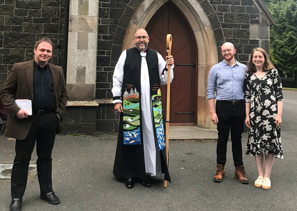 Bishop George Davison, with Neville, Cameron and Megan from The Church of the Resurrection at Queen's University who were confirmed in Christ Church, Lisburn, on May 28.