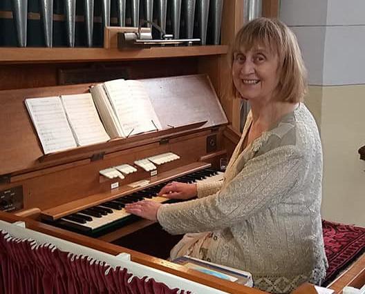 Rosemary Steele BEM at the organ in St John's Parish Church, Stoneyford.