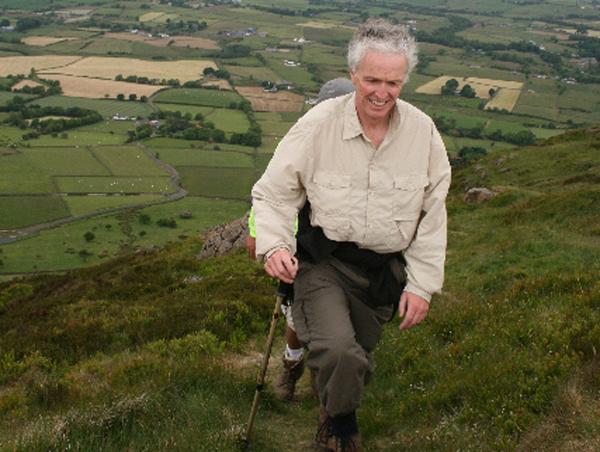June 2008 - Canon Stuart Lloyd ascending Slemish as part of his fundraising 'Everest' hike. He is inviting people to join him when he undertakes this challenge again in 2021.