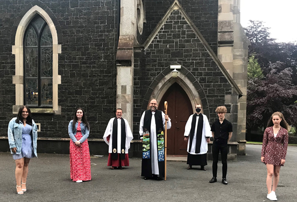 Bishop George Davison, the Ven Paul Dundas, rector and the Rev Derek Harrington, curate, with the teenagers who were confirmed in Christ Church, Lisburn, on May 28.