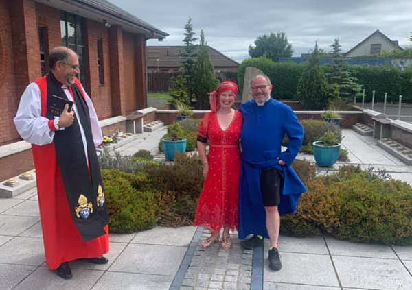 The Rev Canon Kevin Graham and his wife Cheryl with Bishop George Davison after Kevin and Cheryl renewed their wedding vows in St Colman's, Kilroot, the halfway point of Kevin's fundraising marathon walk.
