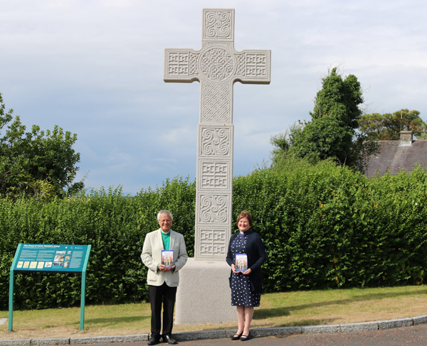 The Very Rev Henry Hull, Dean of Down, and the Rev Karen Salmon, pictured with 'St Patrick's Pilgrimages - Journey to Place, Journey to God' at St Patrick's High Cross, a replica of the eighth century original, at Down Cathedral, Downpatrick.