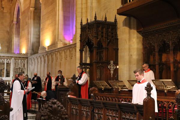 The Most Rev Dr Michael Jackson, Archbishop of Dublin, presents the Metropolitan Cross to Archbishop John McDowell.