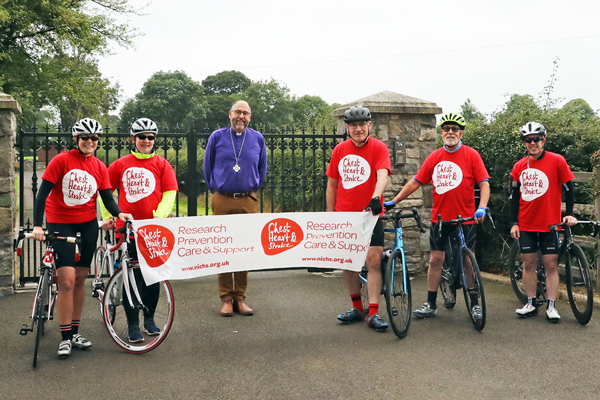 The Bishop of Connor, the Rt Rev George Davison, stepped out to wish the cyclists all the best as they passed See House in the early stages of the 83 mile loop.