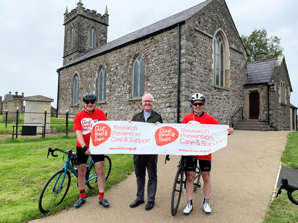 The Rev Ian Magowan welcomes the cyclists at St Saviour's, Kells.
